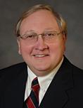 John E. Szewczyk, M.D.